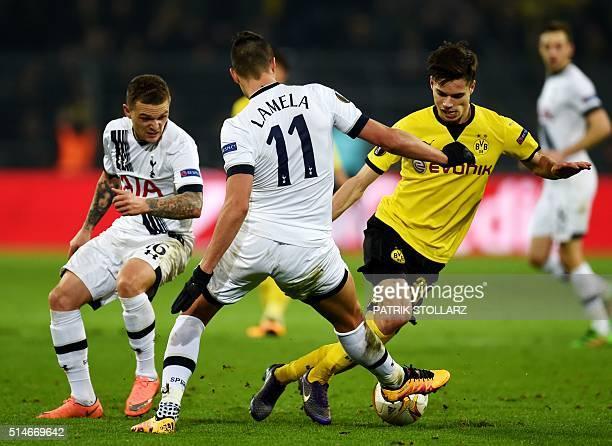 Dortmund's midfielder Julian Weigl vies with Tottenham´s Erik Lamela during the UEFA Europe League Round of 16 first leg football match between...