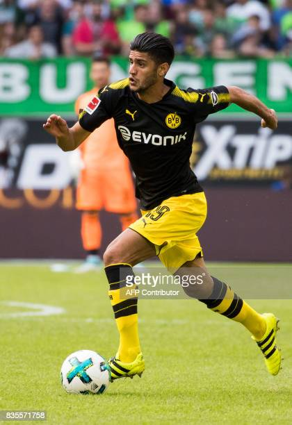 Dortmund´s midfielder Mahmoud Dahoud runs with the ball during the German first division Bundesliga football match Wolfsburg v Dortmund at the...