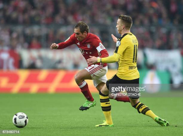 DortmundÕs midfielder Marco Reus and Bayern Munich's defender Philipp Lahm vie for the ball during the German Cup DFB Pokal semifinal football match...