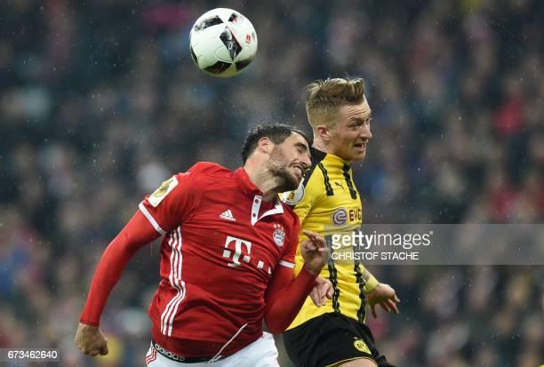 Dortmund's midfielder Marco Reus and Bayern Munich's Spanish midfielder Javi Martinez vie for the ball during the German Cup DFB Pokal semifinal...
