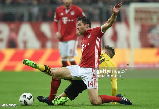 DortmundÕs midfielder Marco Reus and Bayern Munich's Spanish midfielder Xabi Alonso vie for the ball during the German Cup DFB Pokal semifinal...