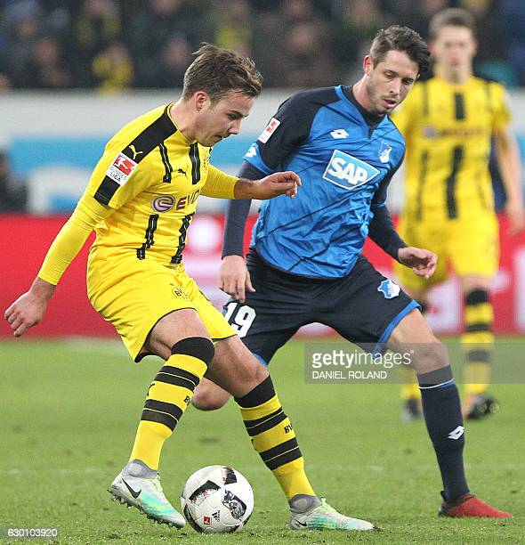 Dortmund's midfielder Mario Goetze and Hoffenheim's forward Mark Uth vie for the ball during the German first division Bundesliga football match...