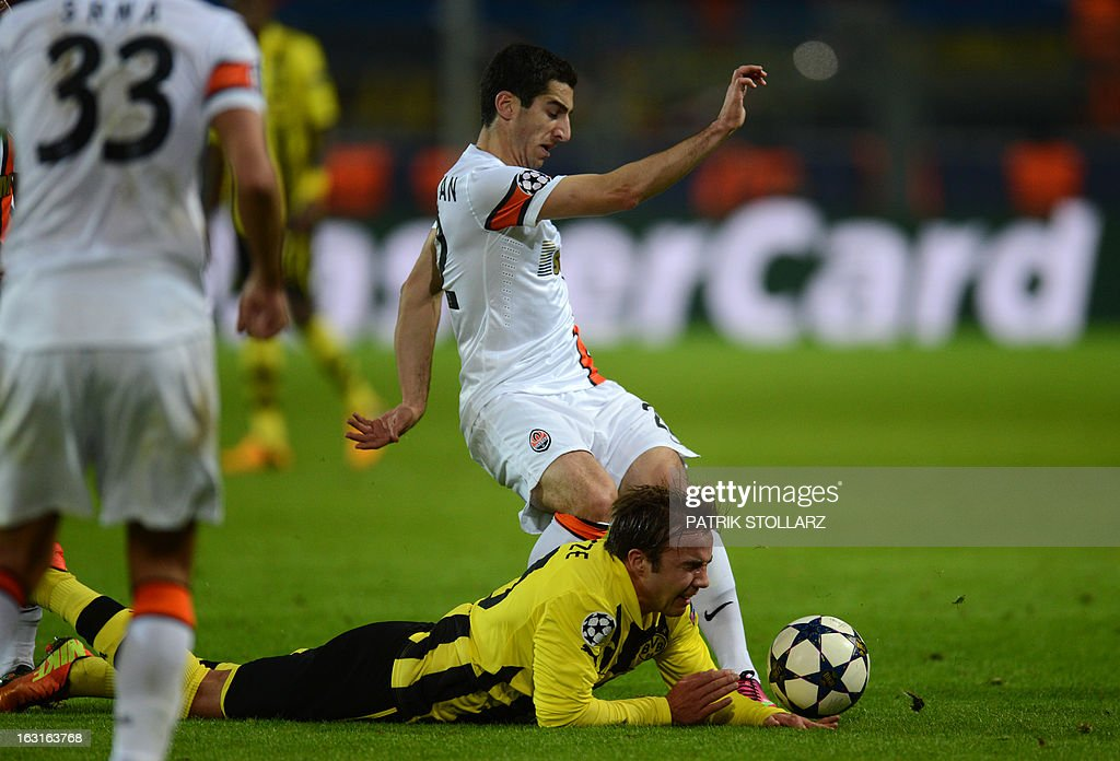 Dortmund's midfielder Mario Goetze (bottom) and Shakhtar Donetsk's Armenian striker Henrikh Mkhitaryan (R) vie for the ball during the UEFA Champions League last 16, second leg match Borussia Dortmund vs Shakhtar Donetsk in Dortmund, western Germany, on March 5, 2013.