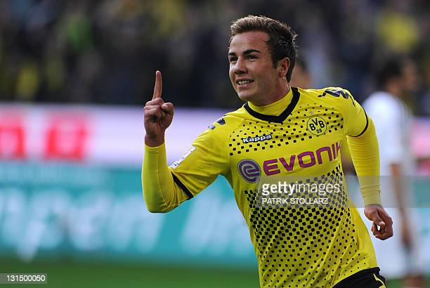 Dortmund's midfielder Mario Goetze celebrates scoring during the German first division Bundesliga football match Borussia Dortmund vs VfL Wolfsburg...