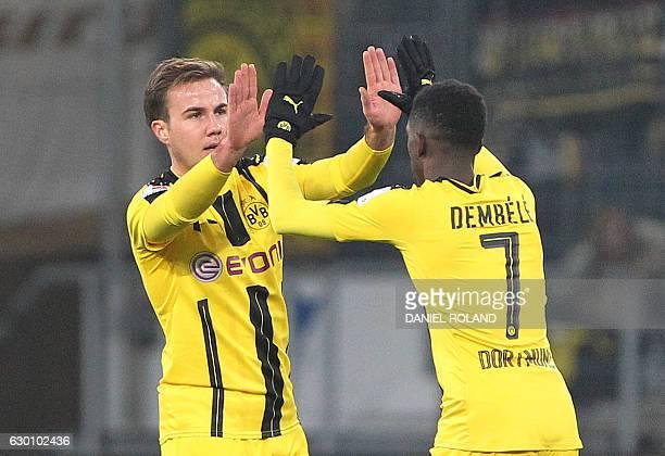 Dortmund's midfielder Mario Goetze celebrates scoring the 11 with Dortmund's French midfielder Ousmane Dembele during the German first division...