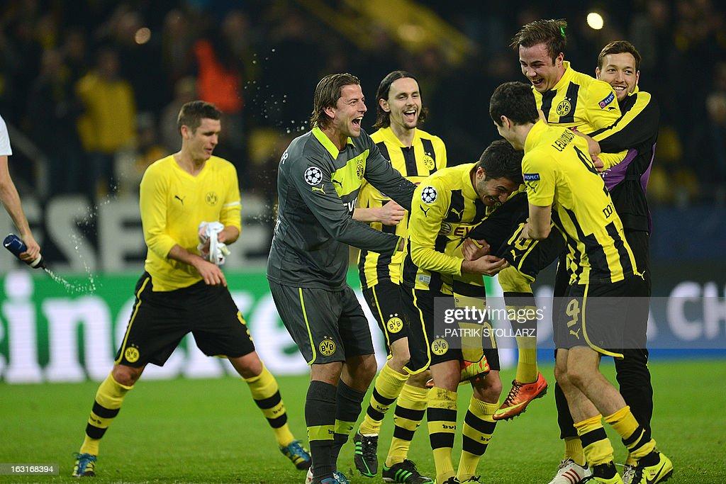 Dortmund's midfielder Mario Goetze (2ndR) celebrates with teammates after the UEFA Champions League last 16, second leg match Borussia Dortmund vs Shakhtar Donetsk in Dortmund, western Germany, on March 5, 2013.