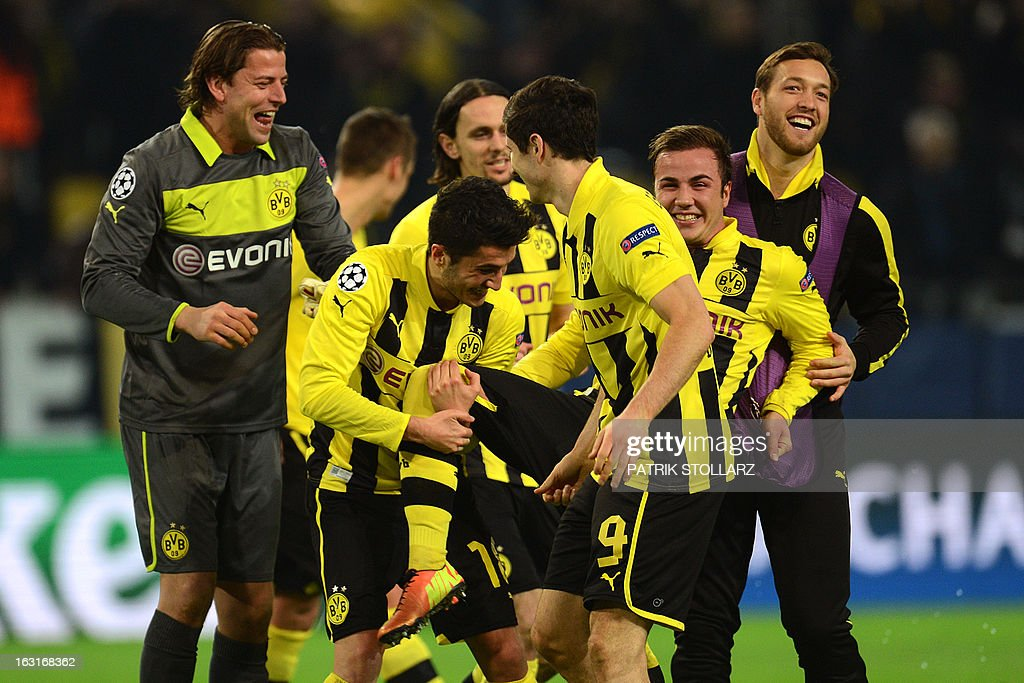 Dortmund's midfielder Mario Goetze (2ndR) celebrates with teammates during the UEFA Champions League last 16, second leg match Borussia Dortmund vs Shakhtar Donetsk in Dortmund, western Germany, on March 5, 2013.
