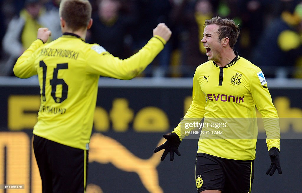 Dortmund's midfielder Mario Goetze (R) reacts during the German first division Bundesliga football match Borussia Dortmund vs Hamburger SV in the German city of Dortmund on February 9, 2013. Hamburg won 1-4.