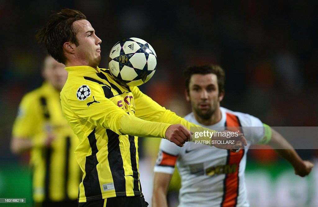 Dortmund's midfielder Mario Goetze (L) runs with the ball during the UEFA Champions League last 16, second leg match Borussia Dortmund vs Shakhtar Donetsk in Dortmund, western Germany, on March 5, 2013. Dortmund won the match 3-0.