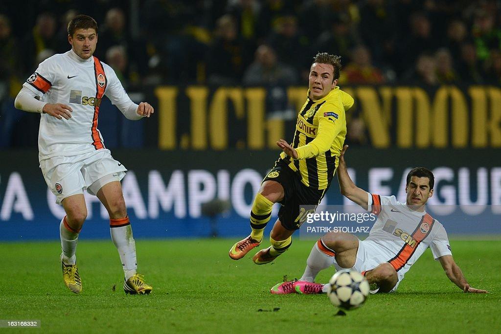 Dortmund's midfielder Mario Goetze (C) vies for the ball during the UEFA Champions League last 16, second leg match Borussia Dortmund vs Shakhtar Donetsk in Dortmund, western Germany, on March 5, 2013.
