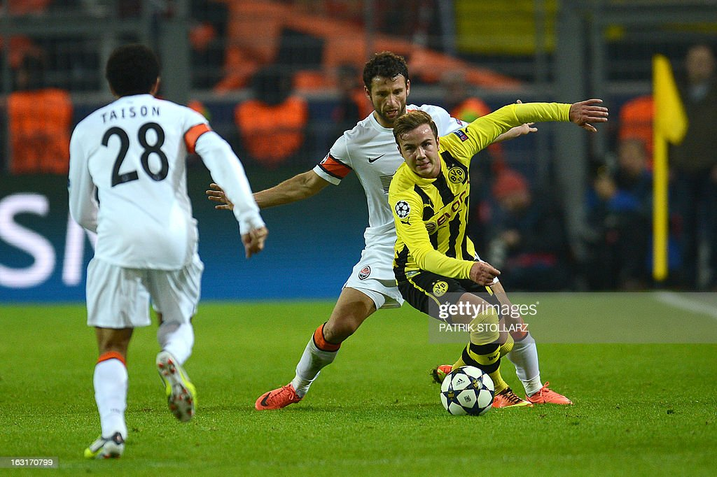 Dortmund's midfielder Mario Goetze (R) vies for the ball during the UEFA Champions League last 16, second leg match Borussia Dortmund vs Shakhtar Donetsk in Dortmund, western Germany, on March 5, 2013.