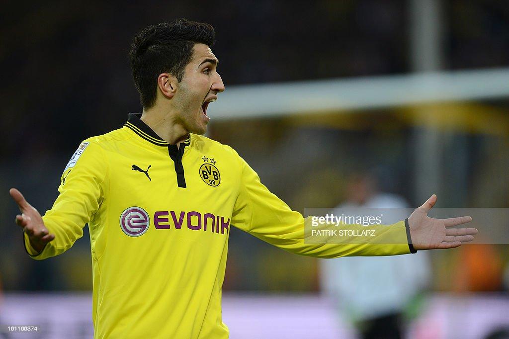 Dortmund's midfielder Nuri Sahin reacts during the German first division Bundesliga football match Borussia Dortmund vs Hamburger SV in the German city of Dortmund on February 9, 2013. Hamburg won 1-4. AFP PHOTO / PATRIK STOLLARZ AT + 49 69 650050