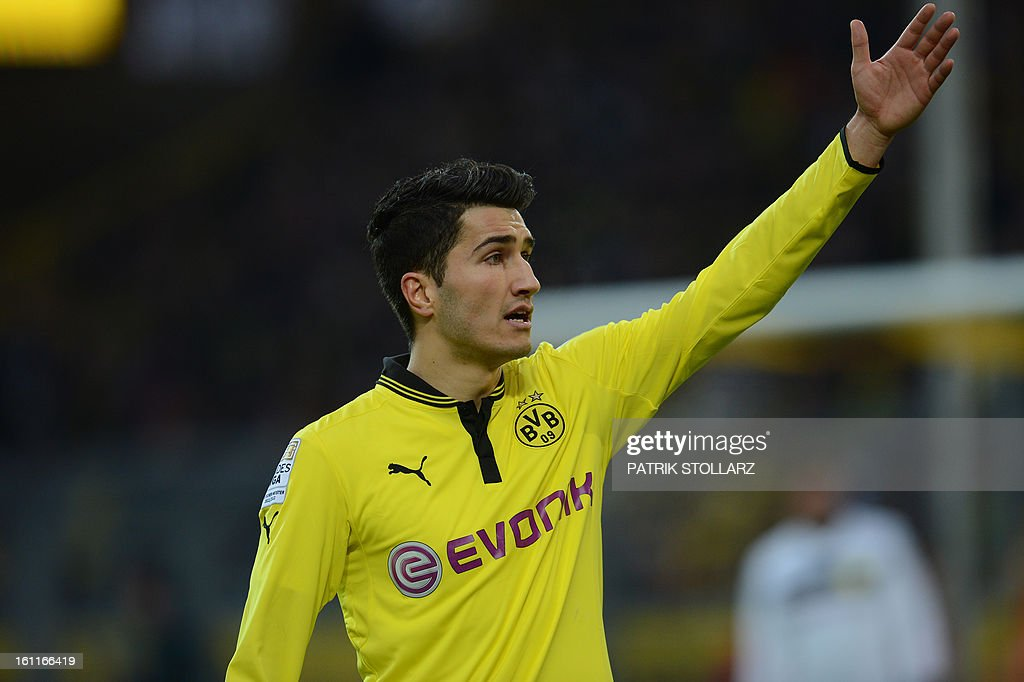 Dortmund's midfielder Nuri Sahin reacts during the German first division Bundesliga football match Borussia Dortmund vs Hamburger SV in the German city of Dortmund on February 9, 2013. Hamburg won 1-4.