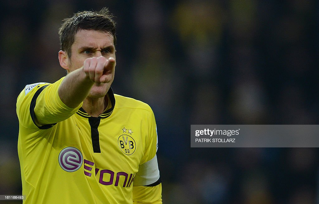 Dortmund's midfielder Sebastian Kehl reacts during the German first division Bundesliga football match Borussia Dortmund vs Hamburger SV in the German city of Dortmund on February 9, 2013. Hamburg won 1-4.