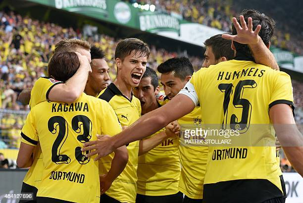 Dortmund's player celebrate during the German first division Bundesliga football match Borussia Dortmund vs Borussia Moenchengladbach in Dortmund...