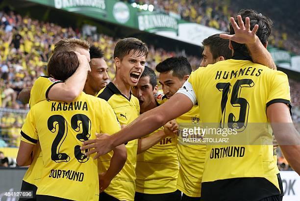 Dortmund's player celebrate during the German first division Bundesliga football match Borussia Dortmund vs Borussia Moenchengladbach in Dortmund...