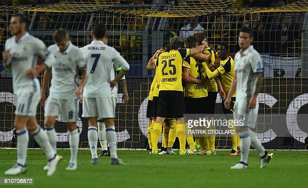 Dortmund's players celebrate after Gabonese forward PierreEmerick Aubameyang scored during the UEFA Champions League first leg football match between...