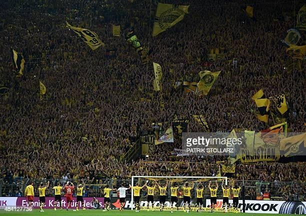 Dortmund´s players celebrate after the German first division Bundesliga football match Borussia Dortmund vs Borussia Moenchengladbach in Dortmund...