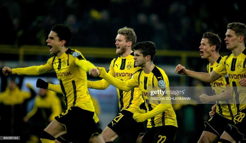 Dortmund's players celebrate after the penalty shoot-out of the German Cup DFB Pokal round of 16 football match BVB Borussia Dortmund v Hertha Berlin in Dortmund, western Germany on February 8, 2017.
