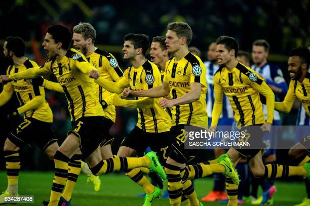 Dortmund's players celebrate after the penalty shootout of the German Cup DFB Pokal round of 16 football match BVB Borussia Dortmund v Hertha Berlin...