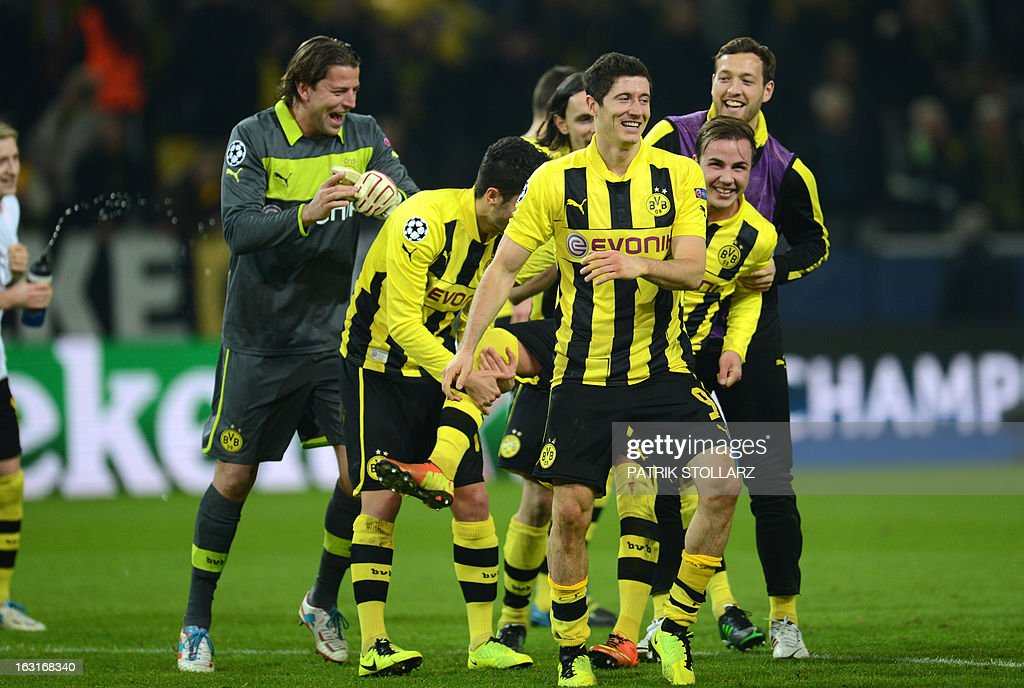 Dortmund's players celebrate after the UEFA Champions League last 16, second leg match Borussia Dortmund vs Shakhtar Donetsk in Dortmund, western Germany, on March 5, 2013. Dortmund won the match 3-0.