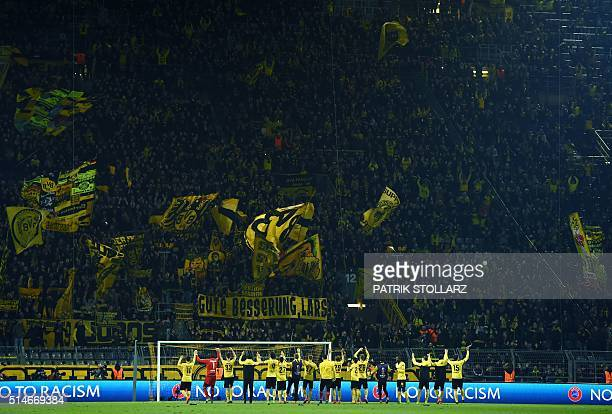 Dortmund´s players celebrate after winning the UEFA Europe League Round of 16 first leg football match between Borussia Dortmund and Tottenham...