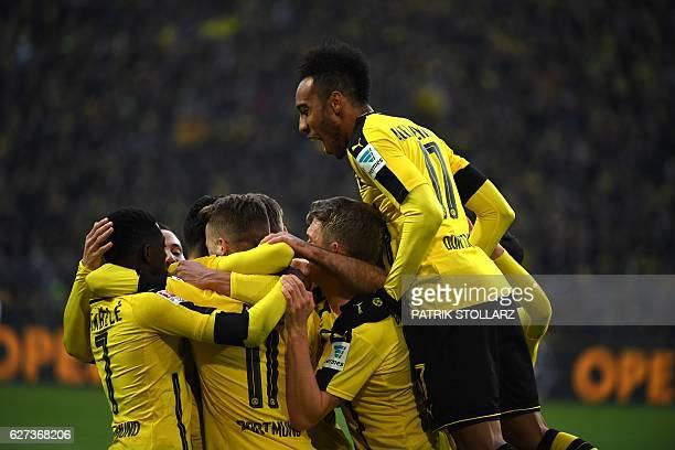 Dortmund's players celebrate during the German first division Bundesliga football match between Borussia Dortmund and Borussia Moenchengladbach at...