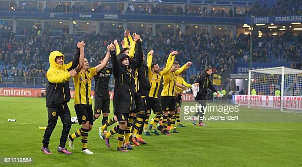 Dortmund's players celebrate fter the German first division Bundesliga football match between Hamburg SV and BVB Borussia Dortmund in Hamburg...