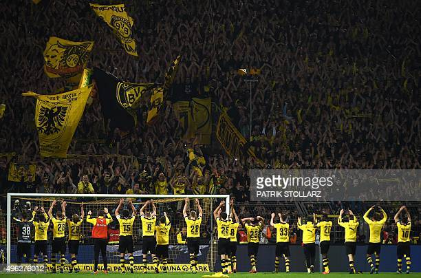 Dortmund's players celebrate with the fans after the German first division football Bundesliga match Borussia Dortmund vs FC Schalke 04 on November 8...