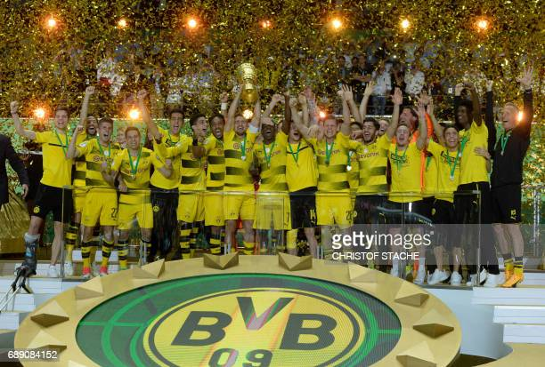 Dortmund's players celebrate with the trophy after the German Cup final football match Eintracht Frankfurt v BVB Borussia Dortmund at the Olympic...
