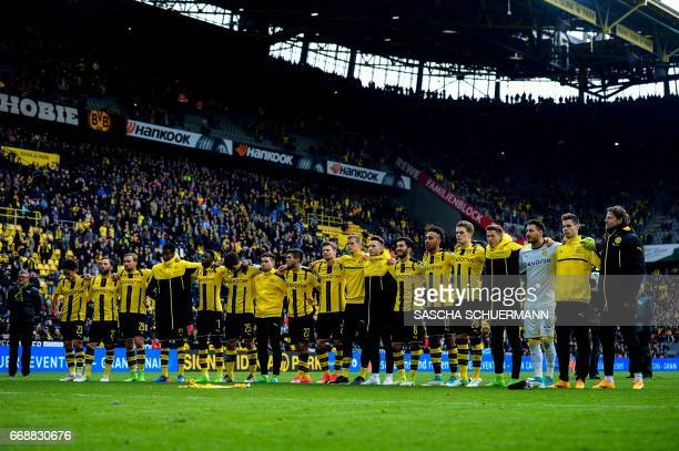 Dortmund's players celebrate with their fans after the German First division Bundesliga football match between Borussia Dortmund and Eintracht...
