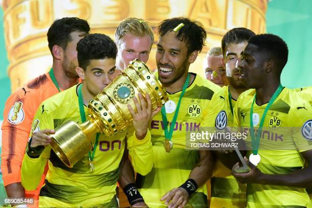 Dortmund's players including Dortmund's Spanish defender Marc Bartra Dortmund's Gabonese forward PierreEmerick Aubameyang and Dortmund's French...