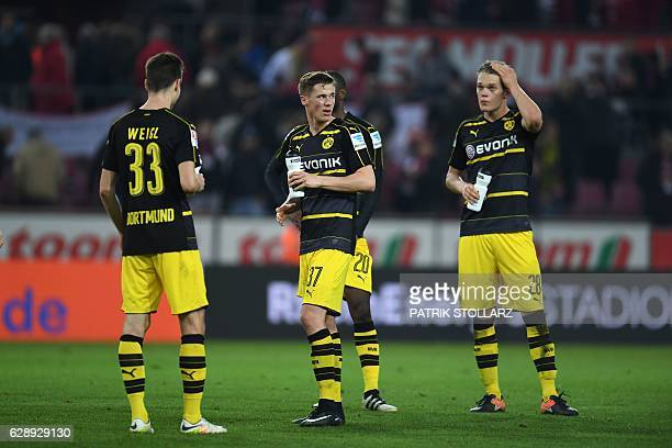 Dortmund's players react after the German first division Bundesliga football match between 1 FC Cologne and Borussia Dortmund in Cologne western...