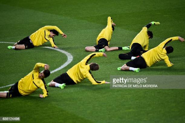 TOPSHOT Dortmund's players warm up during a training session at Luz stadium in Lisbon on February 13 2017 on the eve of their UEFA Champions League...