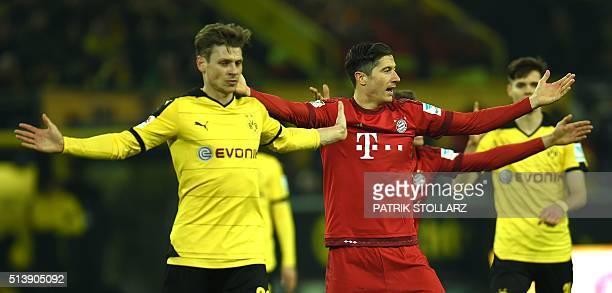 Dortmund's Polish defender Lukasz Piszczek and Bayern Munich's Polish striker Robert Lewandowski react during the German first division Bundesliga...