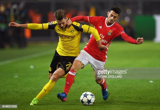 Dortmund's Polish defender Lukasz Piszczek and Benfica's midfielder Pizzi vie for the ball during the UEFA Champions League Round of 16 2ndleg...