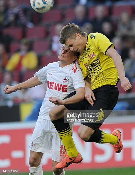 Dortmund's Polish defender Lukasz Piszczek and Cologne's Polish midfielder Slawomir Peszko vie for the ball during the German first division...