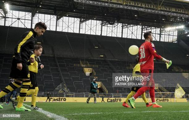 Dortmund's Polish defender Lukasz Piszczek and Dortmund's Swiss goalkeeper Roman Buerki walk prior to the German First division Bundesliga football...