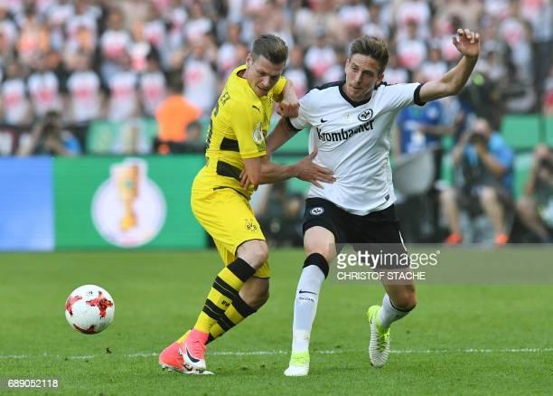 Dortmund's Polish defender Lukasz Piszczek and Frankfurt's defender Bastian Oczipka vie for the ball during the German Cup final football match...