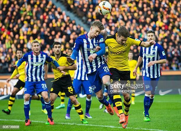Dortmund's Polish defender Lukasz Piszczek and Hertha Berlins midfielder midfielder Mitchell Weiser vie for the ball during the German first division...