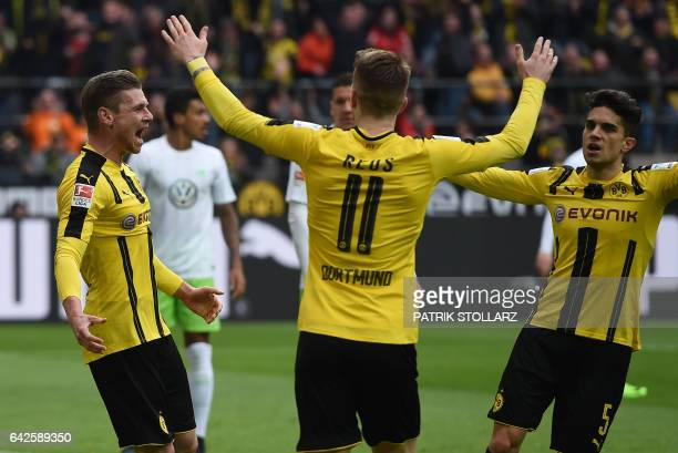 Dortmund's Polish defender Lukasz Piszczek and his teammates celebrate during the German First division Bundesliga football match Borussia Dortmund...