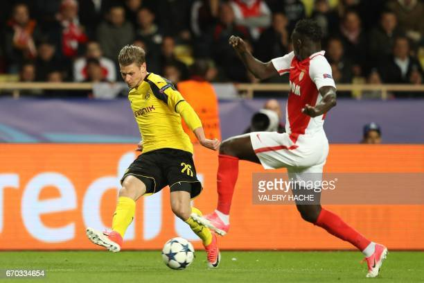Dortmund's Polish defender Lukasz Piszczek centers past Monaco's French defender Benjamin Mendy during the UEFA Champions League 2nd leg quarterfinal...