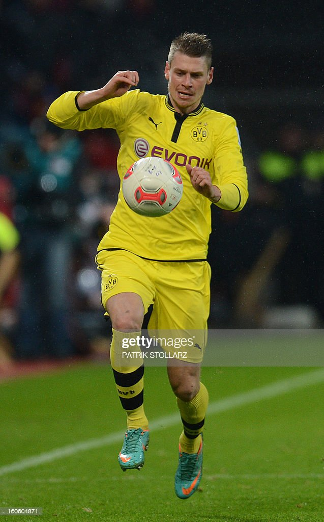 Dortmund's Polish defender Lukasz Piszczek plays the ball during the German first division Bundesliga football match Bayer Leverkusen vs Borussia Dortmund in the western German city of Leverkusen on February 3, 2013. Dortmund won the match 2-3.