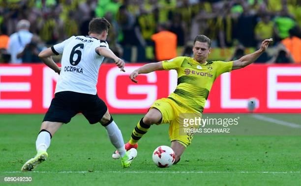 Dortmund's Polish defender Lukasz Piszczek vies for the ball with Frankfurt's defender Bastian Oczipka during the German Cup final football match...