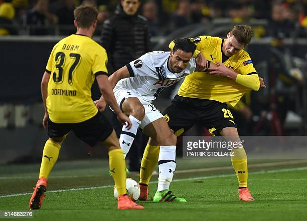 Dortmund's Polish defender Lukasz Piszczek vies with Tottenham´s Nacer Chadli during the UEFA Europe League Round of 16 first leg football match...