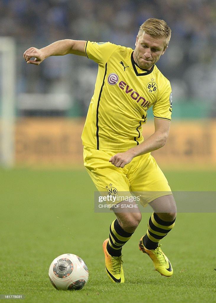 Dortmund's Polish midfielder Jakub Blaszczykowski plays the ball during the second round football match of the German Cup (DFB - Pokal) TSV 1860 Munich vs Borussia Dortmund on September 24, 2013 in Munich, southern Germany. STACHE