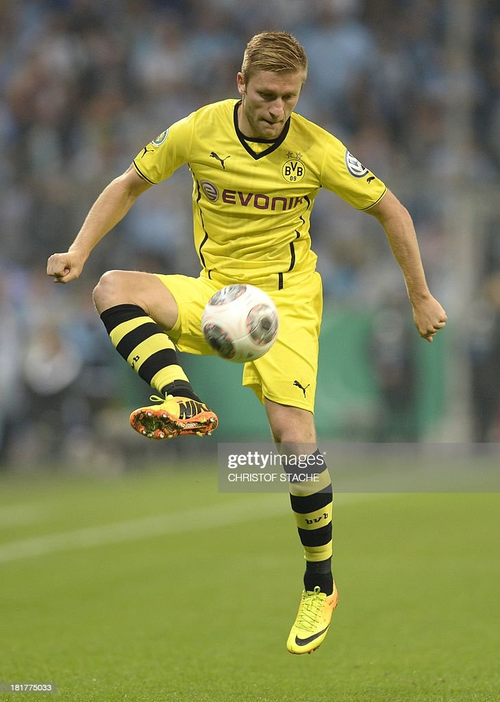 Dortmund's Polish midfielder Jakub Blaszczykowski plays the ball during the second round football match of the German Cup (DFB - Pokal) TSV 1860 Munich vs Borussia Dortmund on September 24, 2013 in Munich, southern Germany. STACHE