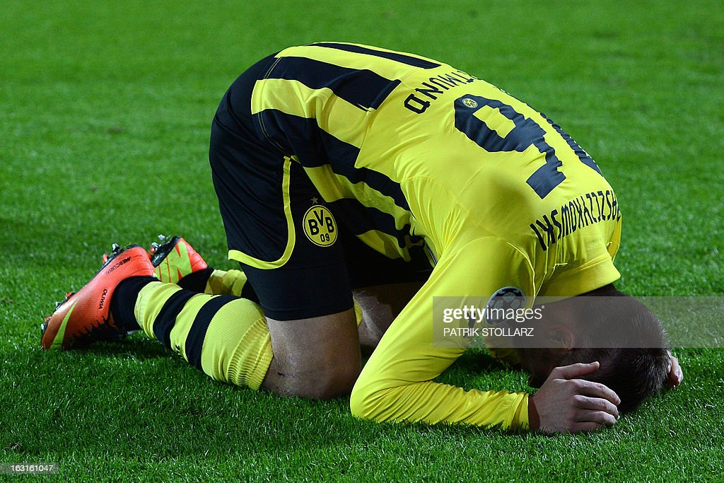 Dortmund's Polish midfielder Jakub Blaszczykowski reacts after scoring during the UEFA Champions League last 16, second leg match Borussia Dortmund vs Shakhtar Donetsk in Dortmund, western Germany, on March 5, 2013.