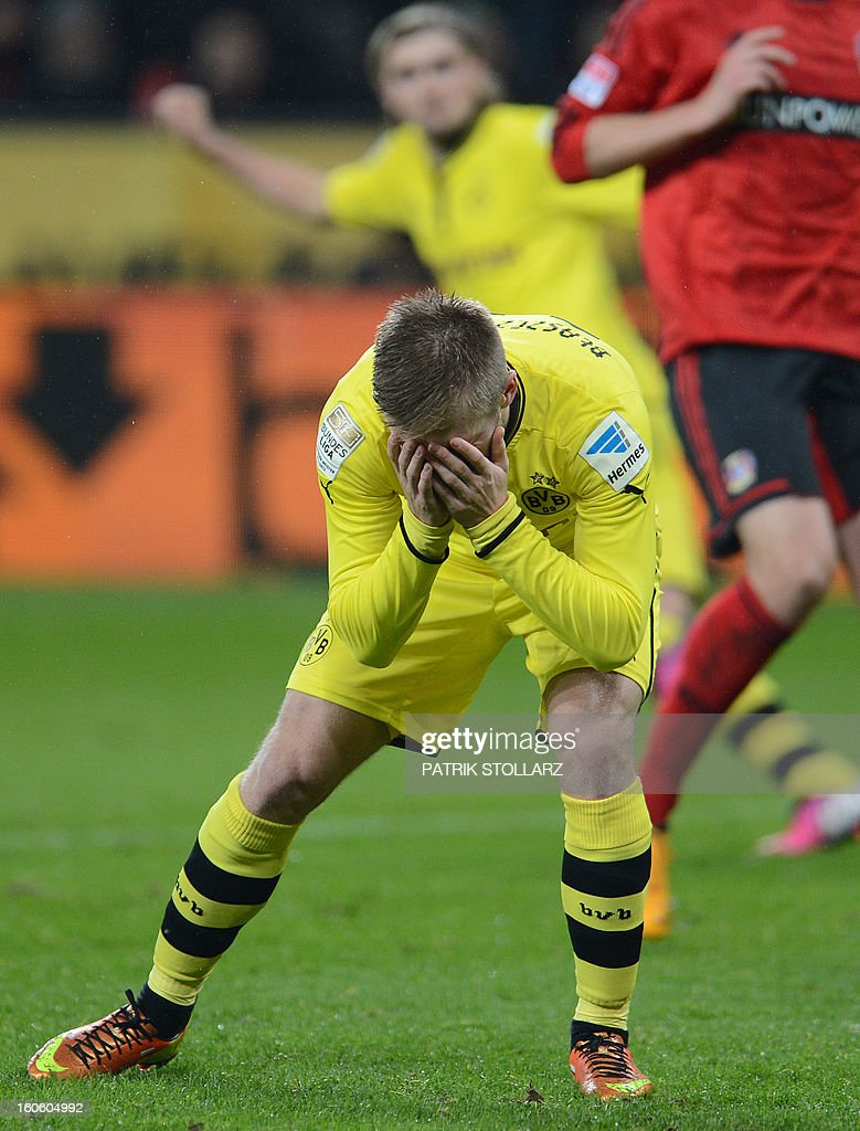 Dortmund's Polish midfielder Jakub Blaszczykowski reacts during the German first division Bundesliga football match Bayer Leverkusen vs Borussia Dortmund in the western German city of Leverkusen on February 3, 2013. Dortmund won the match 2-3.