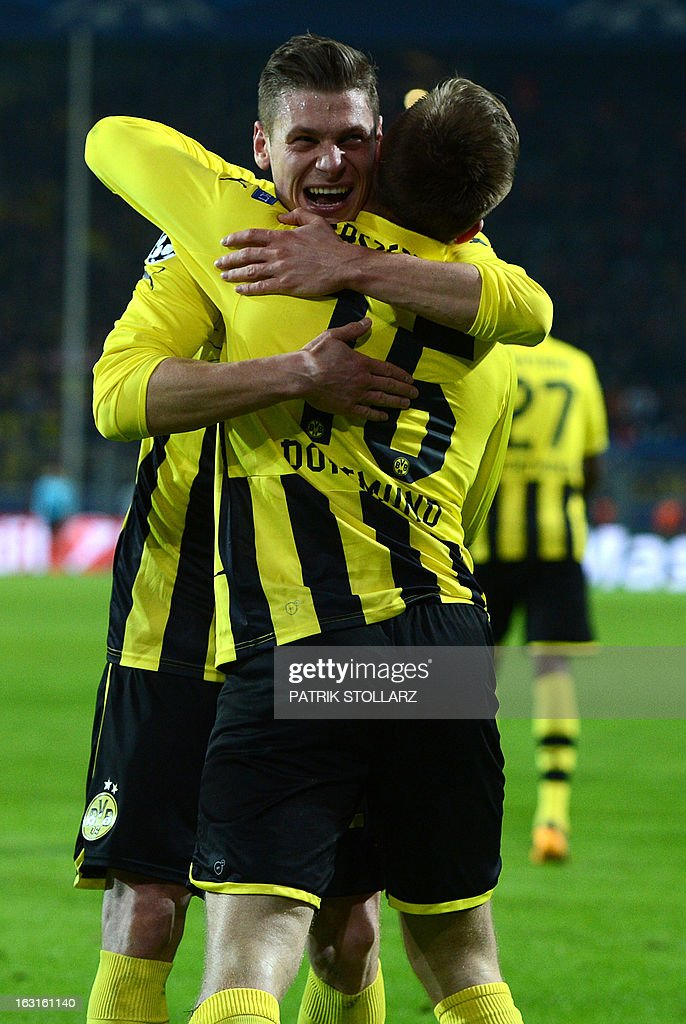 Dortmund's Polish midfielder Jakub Blaszczykowski (front) reacts with teammate after scoring during the UEFA Champions League last 16, second leg match Borussia Dortmund vs Shakhtar Donetsk in Dortmund, western Germany, on March 5, 2013.